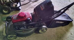 Push mower with a catcher attachment