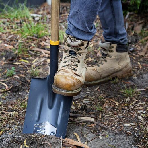 A man using a garden shovel