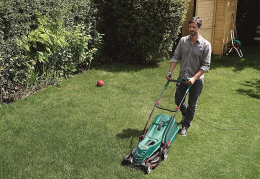 A man using a lawn mower
