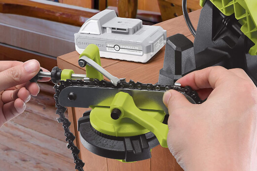 A chainsaw sharpener being used