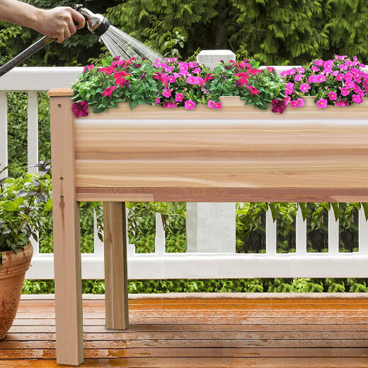 Jumbl Raised Canadian Cedar Garden Bed is set at an ergonomic working height to reduce back strain